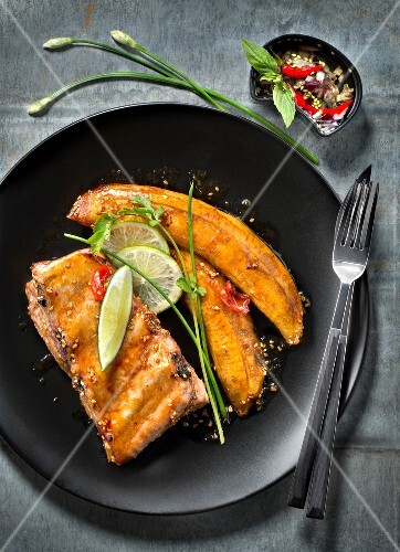 Caramelized pork spare ribs with lime and plantain bananas