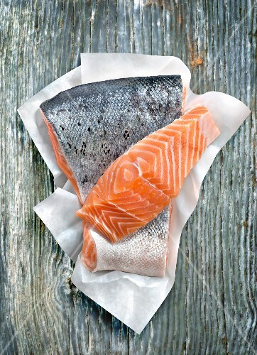Piece of raw salmon on paper