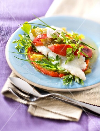Layered halibut,peppers and fresh herbs with roasted pink garlic