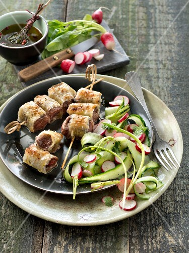 Spicy beef filo pastry brochettes,radish and cucumber salad