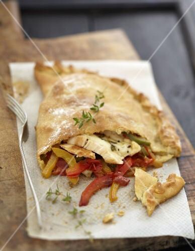Chicken,mozzarella and piperade Calzone pizza