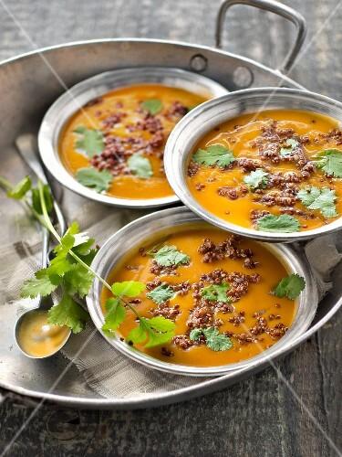 Sweet potato soup with red quinoa and cilantro