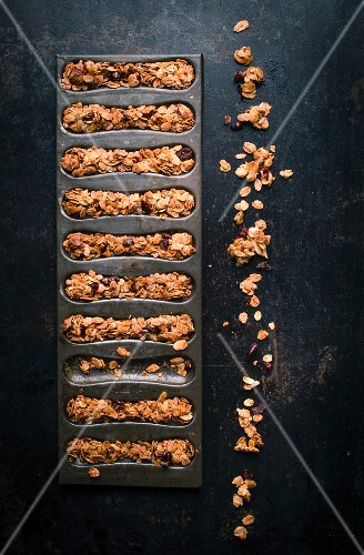 Mixed granola in a mould to make cereal bars