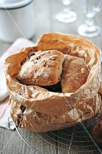Brown paper bag of muesli bread buns