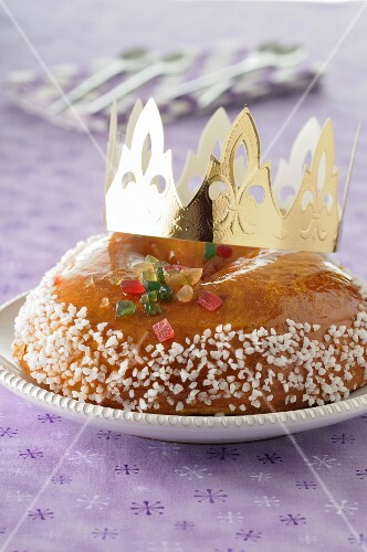 Brioche Galette des Rois with a golden paper crown