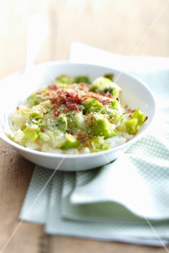 Chopped leeks with thinly sliced raw ham