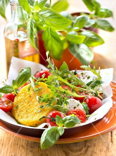 Polenta galette with cherry tomato,rocket lettuce,goat's cheese and herb salad