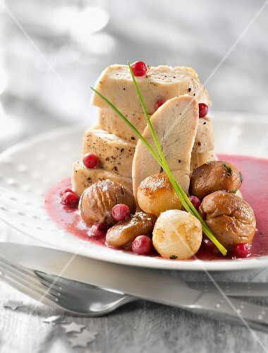 Roasted capon supreme with cranberry sauce and chestnuts