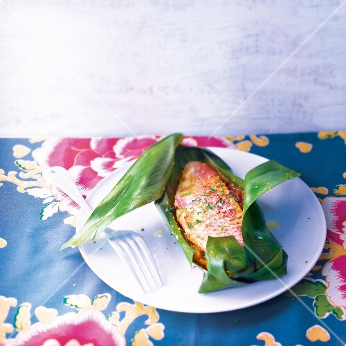 Emperor red snapper cooked in a banana leaf
