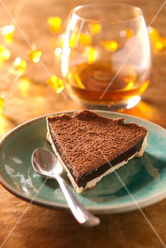 Slice of bitter chocolate and Cognac pie