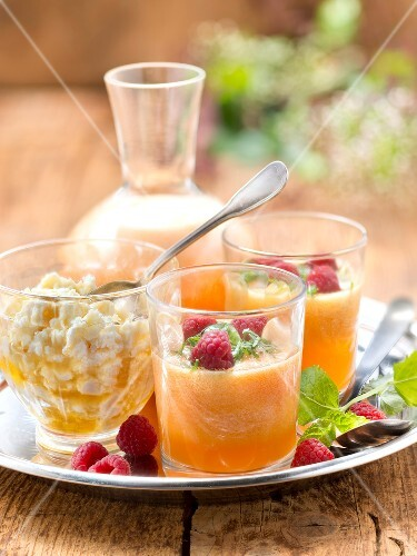 Melon soup with raspberries and Brousse cheese with honey