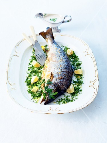 Oven-baked Adriatic salmon stuffed with lemon and herbs