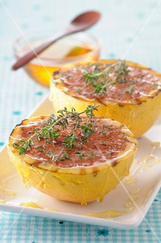 Roasted pomelos with honey and thyme