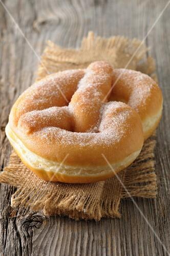 Bretzel-shaped sugar donut