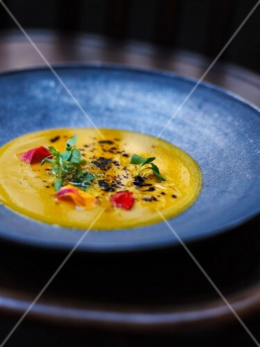 Pumpkin soup with edible flowers