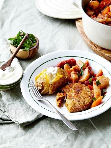 Potato cake with stewed potatoes and peeled tomatoes,baked potato