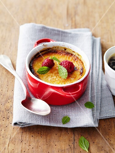 Almond baked egg custard casserole with raspberries and mint