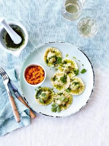 Raviolis stuffed with ricotta,pesto and cilantro ,mashed pumpkins