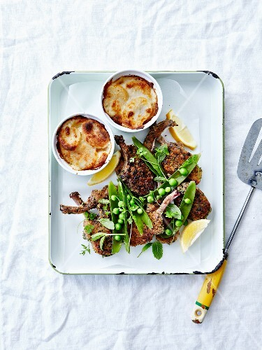 Grilled breaded lamb chops with peas and mini turnp Gratin Dauphinois