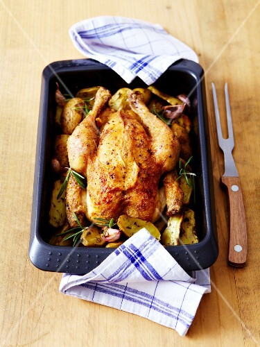 Roasted chicken and garlic with rosemary