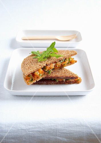 Raw marinate salmon and chive brown bread sandwich