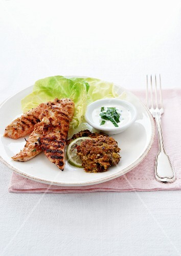 Thinly sliced marinated chicken, grilled slices of lime, veal patties and creamy mint sauce