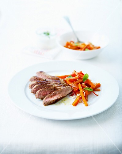 Beef fillet and carrots with garlic and mint