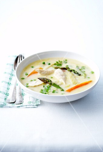 Cream of potato soup with chicken and spring vegetables
