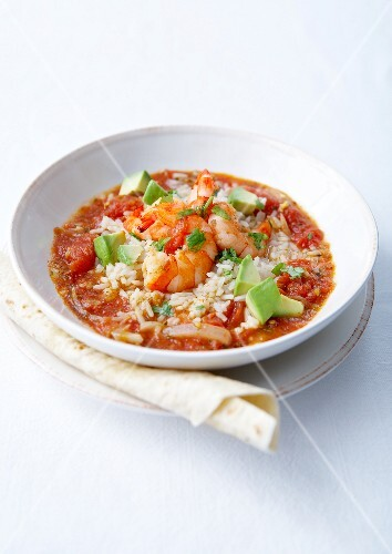 Rice in spicy tomato sauce,avocado and shrimps