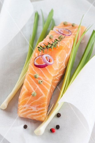 Piece of salmon on a sheet of wax paper