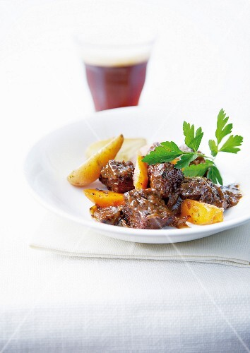 Wild boar stew cooked with beer, potatoes and carrots