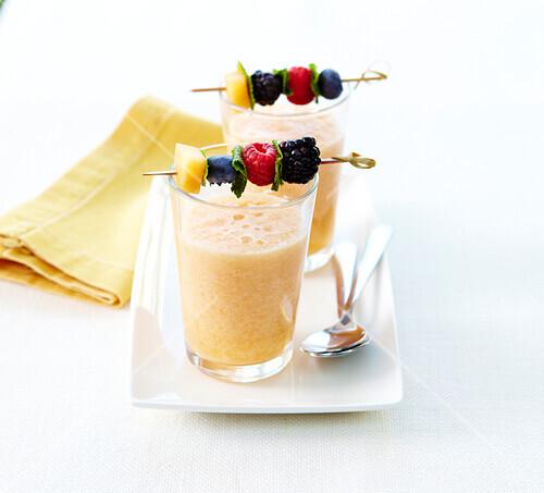 Yellow fruit smoothie with fresh fruit brochettes