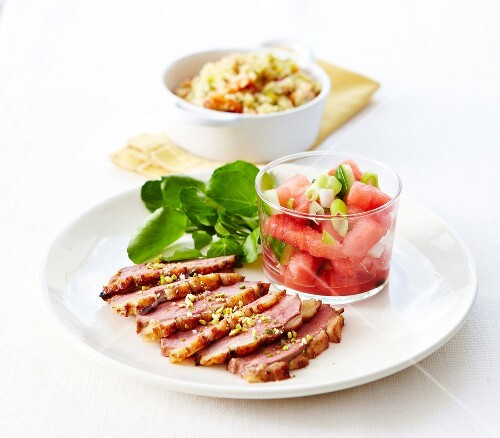 Grilled duck magret with crushed pistachios,watarmelon fruit salad