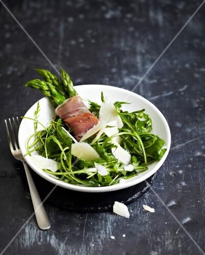 Dandelion salad with parmesan,asparagus and raw ham bundles