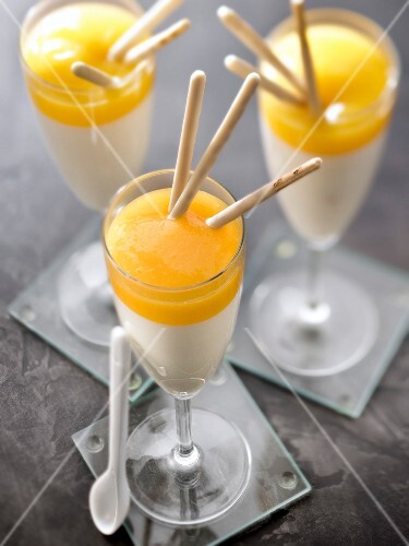 Panacotta with mango puree and white chocolate Mikado