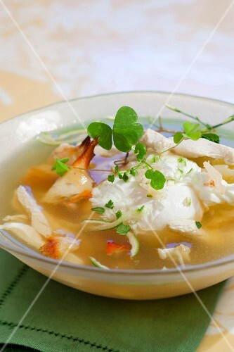 Poached egg in chicken broth with crab and Oxalys