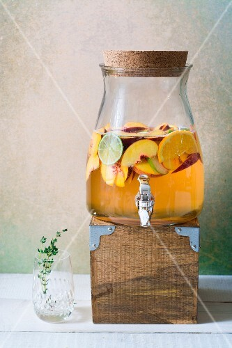 Large jug of peach and thyme Sangria
