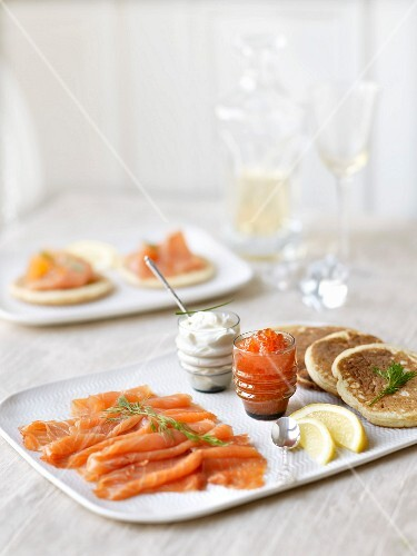 Dish of smoked salmon, blinis and salmon roe
