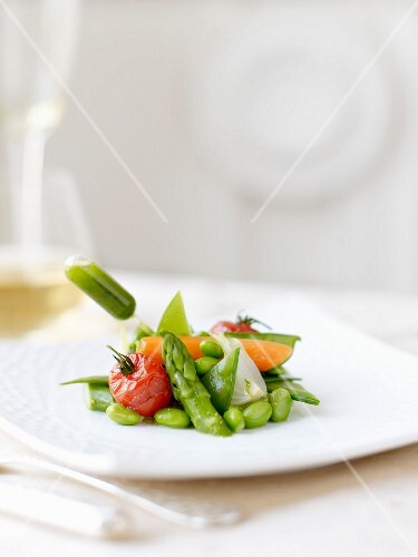 Spring vegetables and a pipette of herb sauce