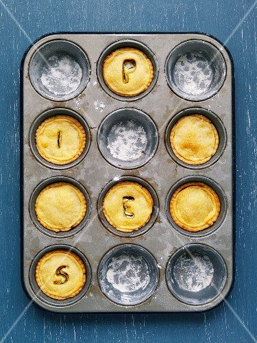 Feta-zucchini mini pies in a baking mould