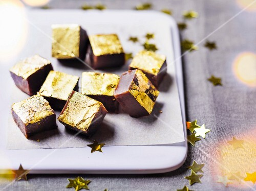 Toffees coated in golden flakes