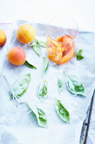 Crushed apricots and crystallized basil leaves