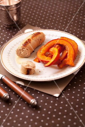 Grilled white sausage and roasted pumpkin