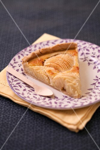 Slice of apple and almond pie