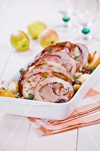 Thick round pork fillet stuffed with apples and pistachios