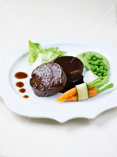 Venison fillet ,sucrine,carrots,peas and glazed spring onions,Poivrade sauce