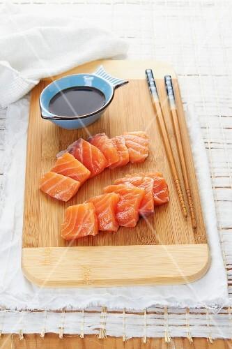 Salmon sashimis with soya sauce