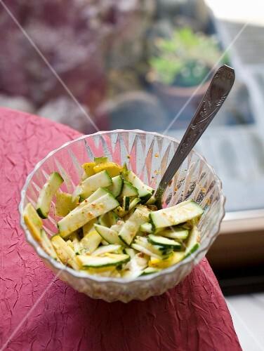 Raw green and yellow zucchinis