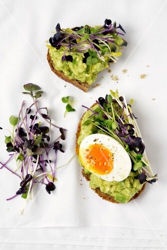 Avocado,soft-boiled egg and watercress open sandwich