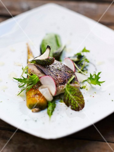 Grilled mullet with squid ink,glazed carrots and cabbage and wasabi puree